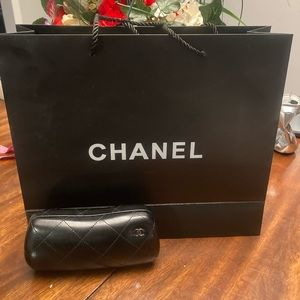 Chanel eyeglasses case with shopping bag.